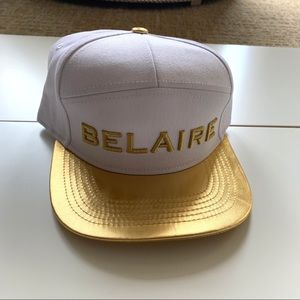Gold and white Belaire hat